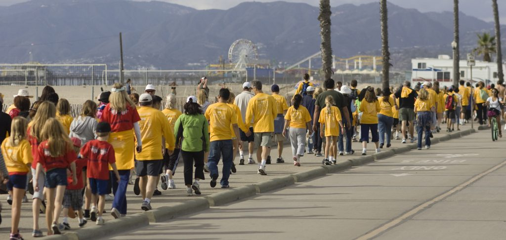 Groups of people wearing support t-shirts walk down the Santa Monica Beach during the 20th Annual Westside Food Bank Hunger Walk on Sunday afternoon. The locally sponsored event raises money and food for people in need of food and other services.